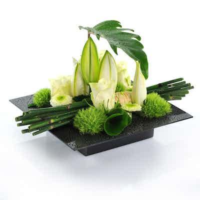 Livraison d'une composition de fleurs blanches